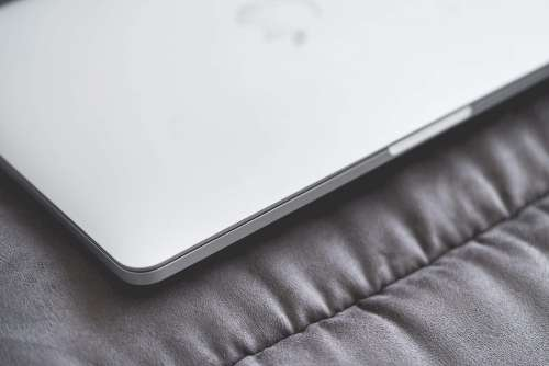 Closed Macbook Laptop on a Sofa #2