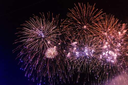 Colorful Fireworks Pyrotechnics Against Black Night Sky
