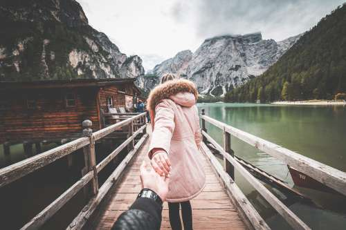 Lovely Couple in Follow Me To Pose on Braies Lake Pier, Italy