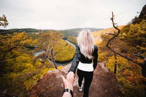 Daredevil Couple Exploring a Dangerous Edge of the Rock