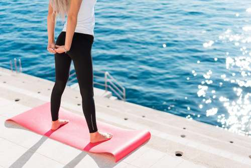 Fit Woman Stretching Her Body in Morning Yoga Routine