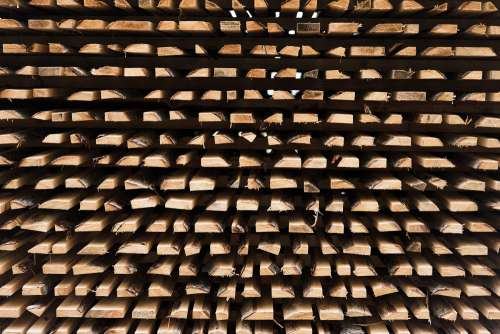 Freshly Cut Wood Stacked for Lumber Air Drying Background Pattern