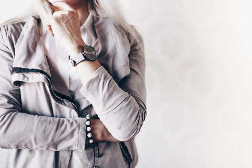 Girl Fashion Pose with Gray Watches and Suede Jacket