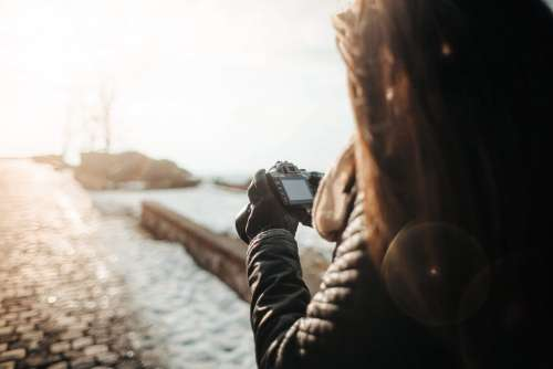 Girl Taking Photographs with her DSLR
