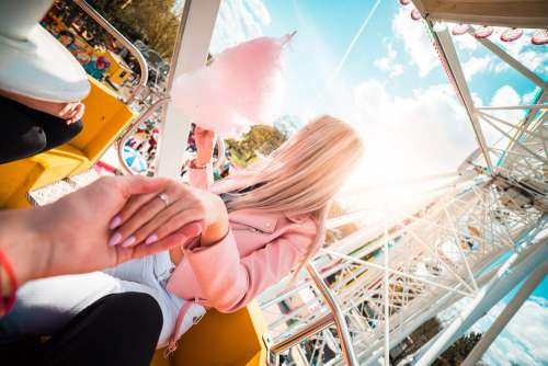Lovely Couple Dating on a Ferris Wheel