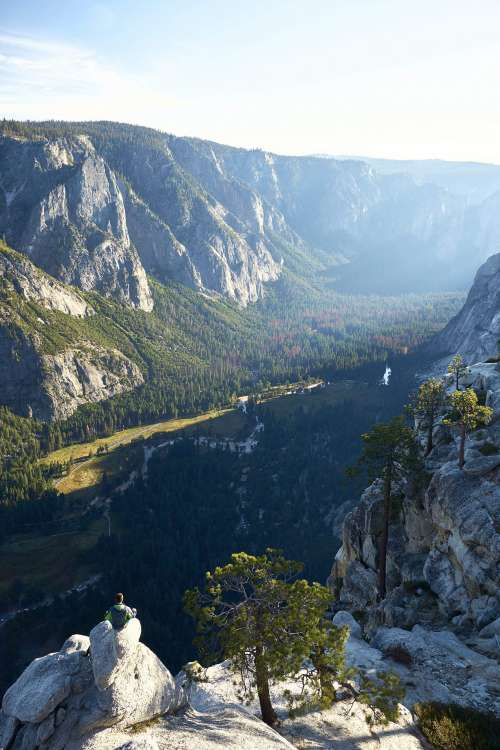 Man Enjoying the View into the Yosemite Valley Vertical