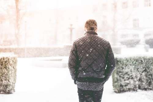 Man Walking in Snowfall