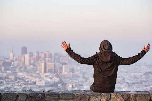 Man with Open Arms Saluting the San Francisco City
