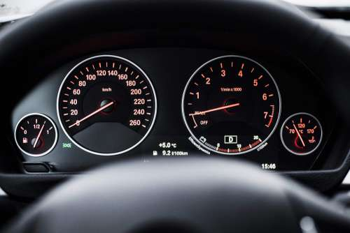 Modern Car Dashboard with Speedometer and Tachometer