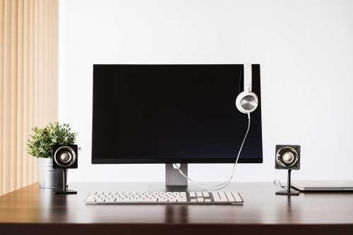 Modern Desktop Setup and White Headphones