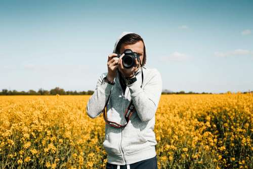 Photographer Taking a Photo in The Field