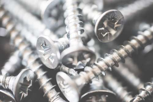 Pile of Silver Flat Crosshead Screws Close Up #2