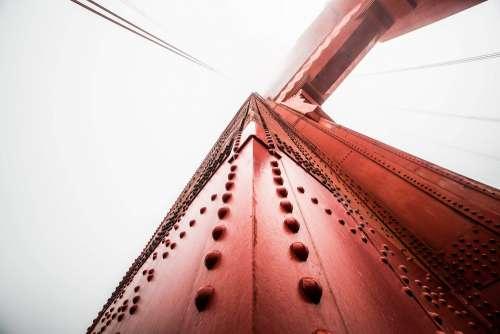 Pillar of The Golden Gate Bridge Against Foggy Sky
