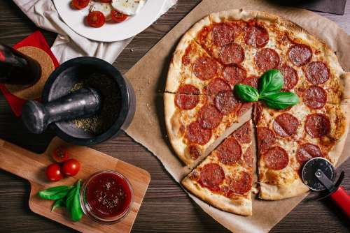 Preparing Salami Pizza