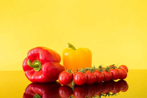 Red and Yellow Paprikas with Tomatoes Still Life