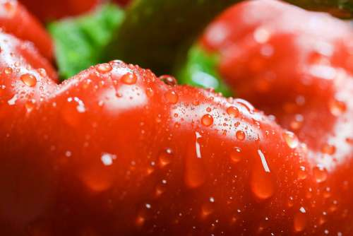 Red Paprika in Water Drops Close Up
