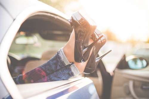 Sexy Woman Legs on High Heels Out of Car Windows