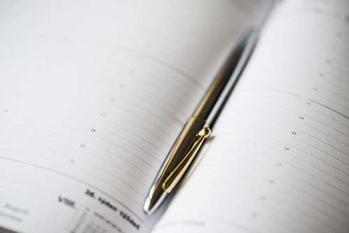Silver Pen in Open Business Day Planner Diary