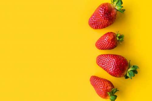 Strawberries with Yellow Background
