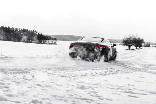 Supercar Drifting on a Snow Covered Road