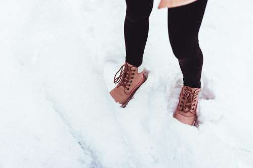 Young Woman in Winter Shoes in Snow