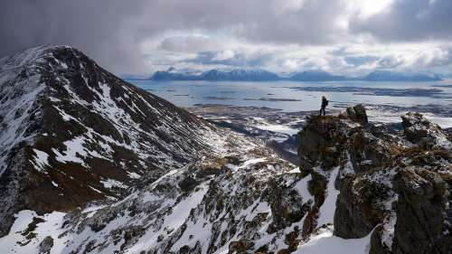 Woman Hiking in Winter Landscape of Northern Norway