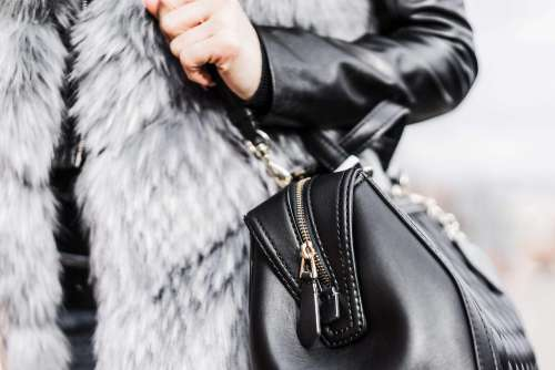 Woman Holding Her Black Leather Bag Close Up