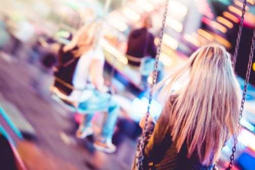 Woman on Carousel Swing Ride