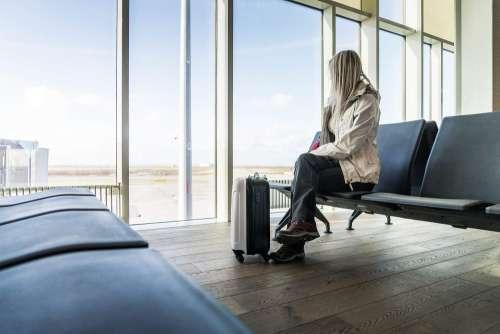 Woman Traveler Waiting at Icelandic Airport