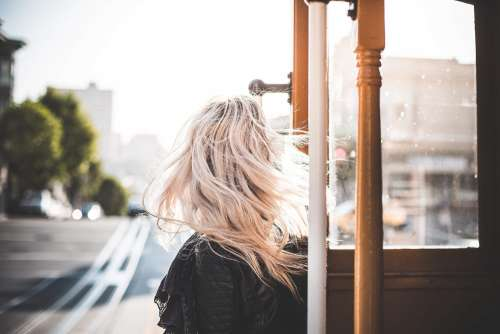 Young Woman Enjoying Ride on an Iconic Cable Car in San Francisco #2