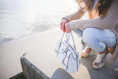 Young Woman with a White Handbag