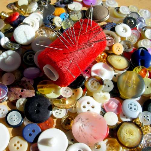 A Lot Buttons Spool Of Thread Red Needles Pins