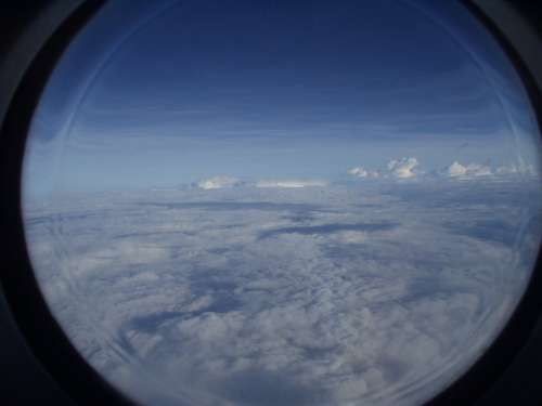 Aircraft Clouds Sky Window Porthole Blue View
