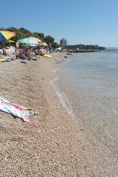 Beach Holidays Sea Stones Tourists