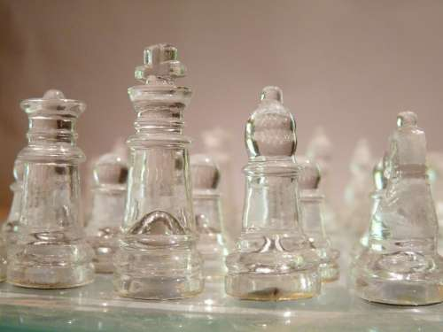 Chess Pieces Glass Game Board Close-Up King