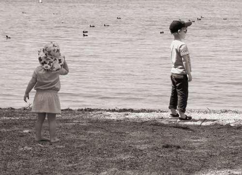 Children Play Beach Black And White Look Water