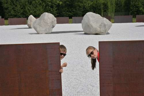 Children Playing Boy Girl Hiding Wall Stone