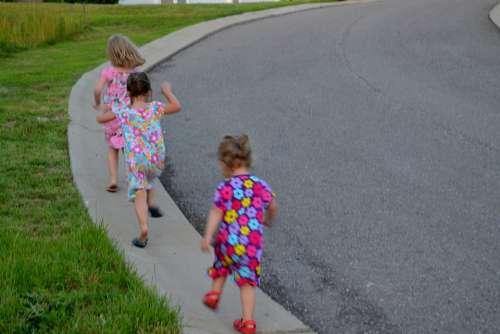 Children Playing Girls Running Hill Outdoor