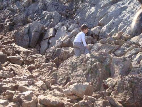 Cliff Stone Child Mountain Kid