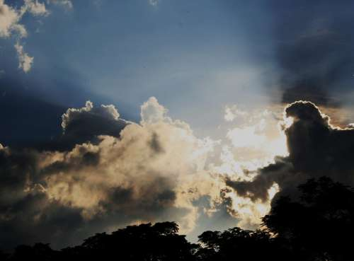 Clouds White Irregular Sun Piercing Radiant Shiny
