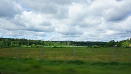 Finnish On The Road Green Fields Forest Clouds