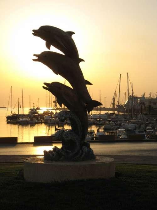 Heraklion Port Island Of Crete Dolphins Sunrise