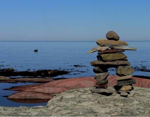 Inukshuk Stones Roche Water River Québec Canada