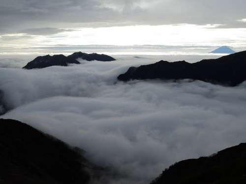 Japan Peaks Clouds Mountains