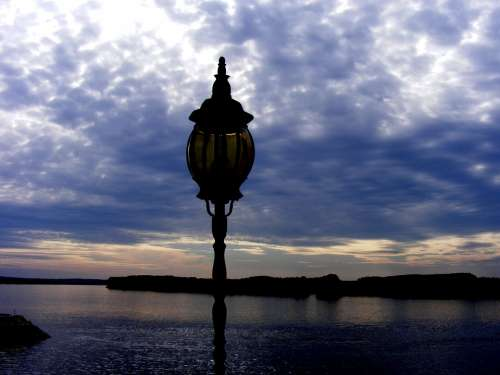 Lantern In The Evening Water Landscape Sunset
