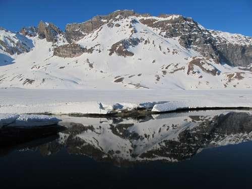 Light Mirroring Mountain Alpine Lake Sky