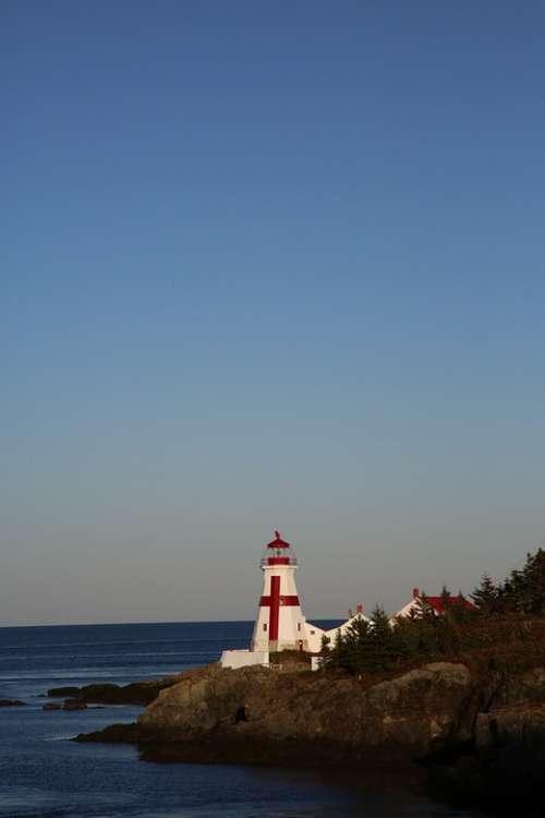 Lighthouse Canada Evening Sea Water Rock Coastal