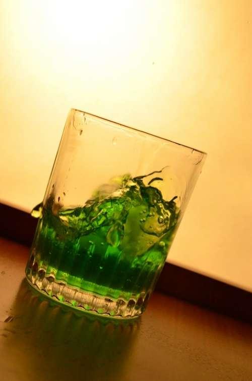 Liquid Green Glass Splash Pouring Alcohol Drink