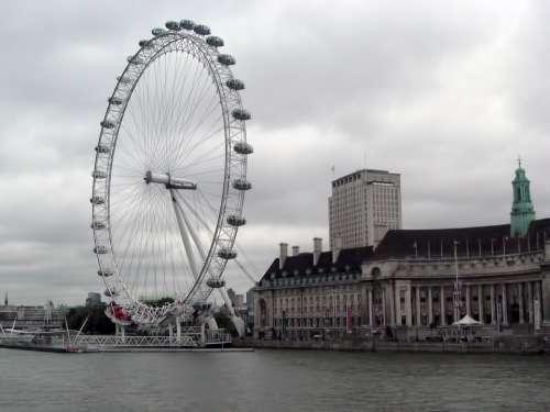 London Eye Ferris Wheel Buildings River Cloudy