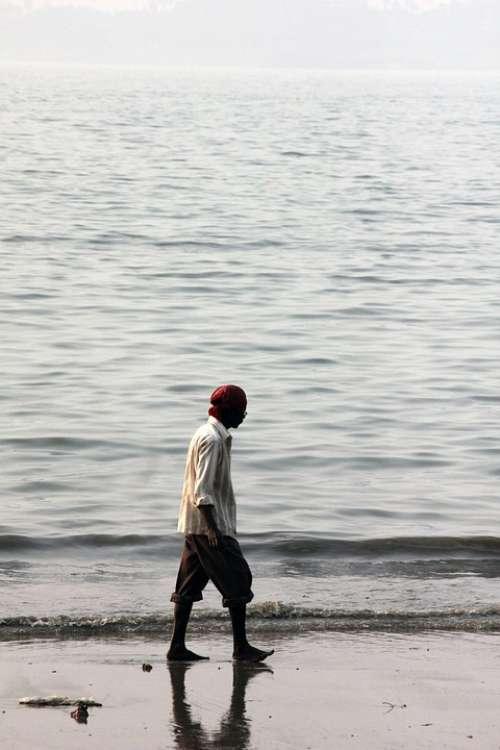 Man Walking Beach Coast Ocean Sea People Person